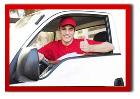 courier man in a van giving the thumbs up and smiling