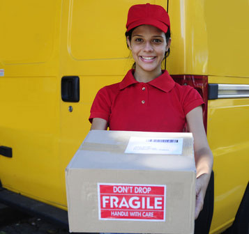 courier handling a box with fragile handle with care message